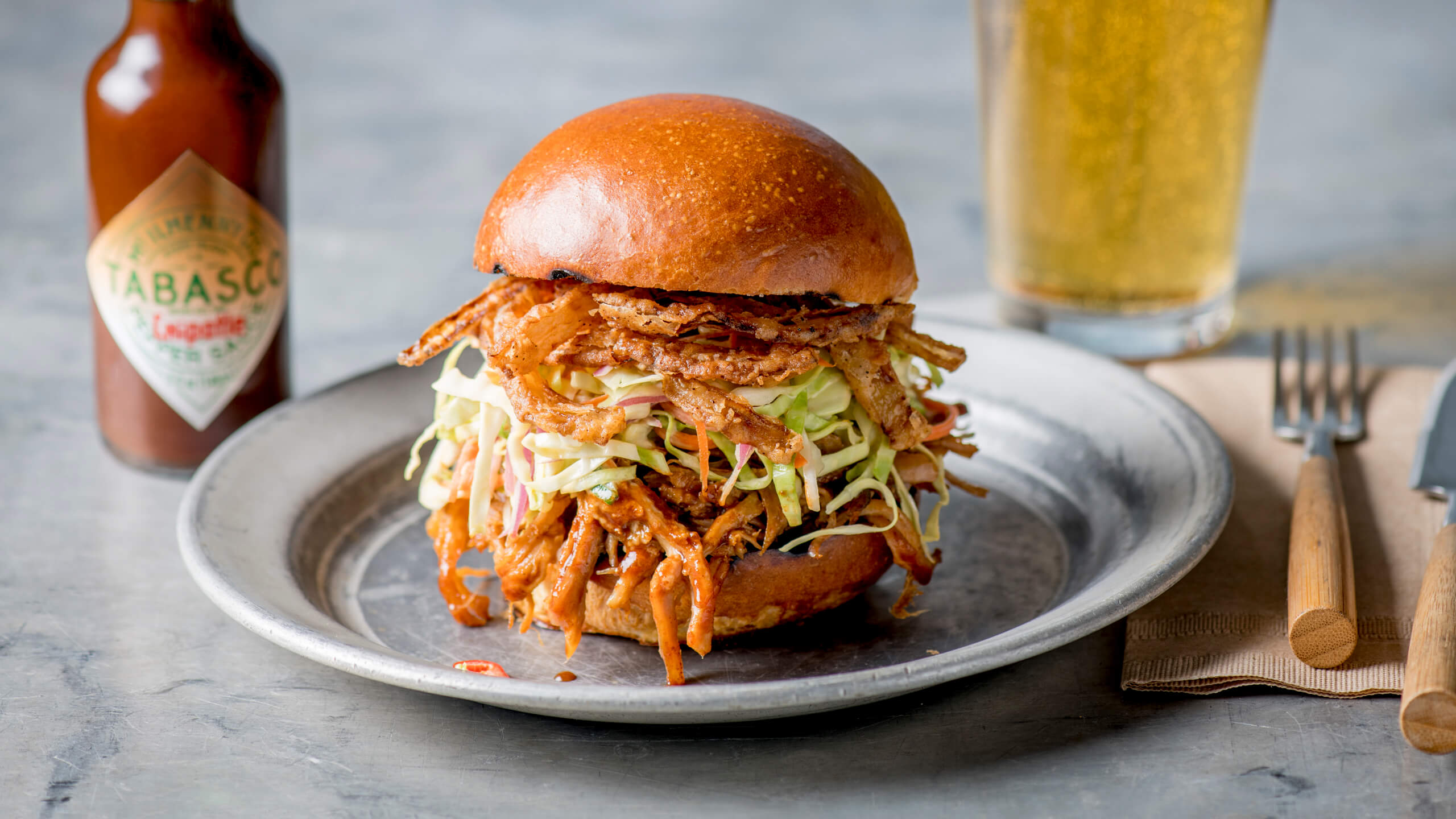 BBQ Pork Sandwich with Onion Straws and Coleslaw