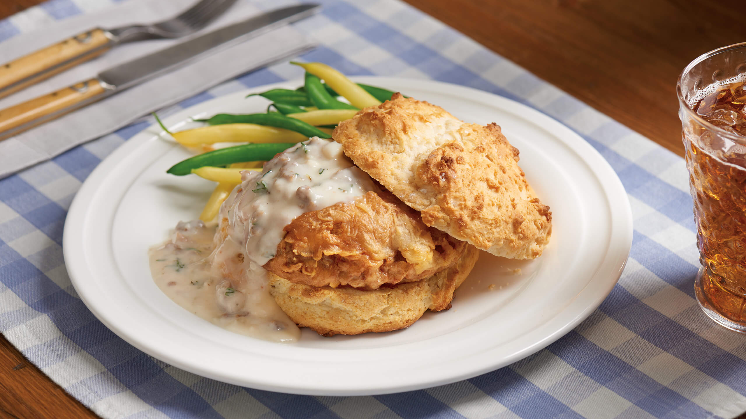 Chicken-Fried Steak Burger with Spicy Sausage Gravy on a Biscuit